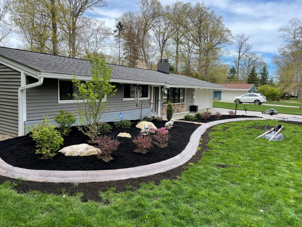 Lake Erie Landscaping team working on a client's front yard.