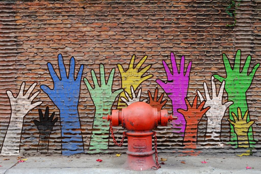 brick wall with graffiti hands