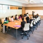 educational workshop people sitting around board room table